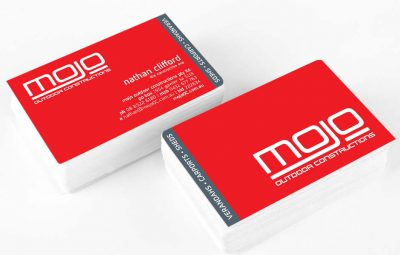 Icon Graphic Design Adelaide - Mojo Outdoor Construction business card design displayed on 2 small stacks of cards.