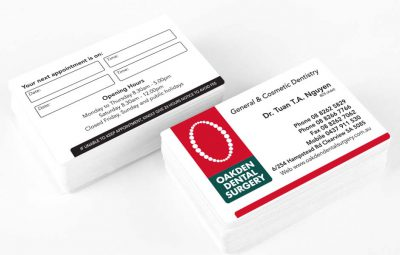 Icon Graphic Design Adelaide - Oakden Dental Surgery business card design displayed on 2 small stacks of cards.