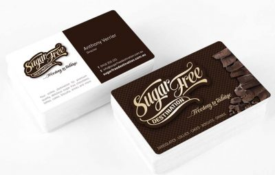 Icon Graphic Design Adelaide - Sugar Free Destination business card design displayed on 2 small stacks of cards.