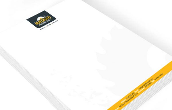 Icon Graphic Design Adelaide - business card design page image of Ruediger Constructions letterhead design displayed on a small stack
