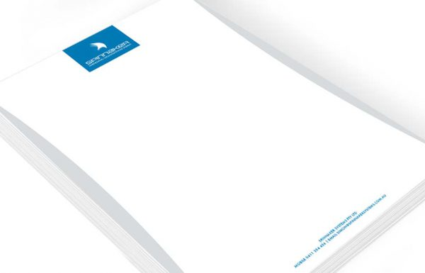 Icon Graphic Design Adelaide - business card design page image of Spinnaker Systems letterhead design displayed on a small stack